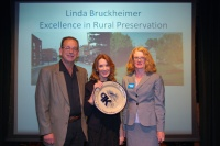 Linda Bruckheimer receives the PK award for Excellence in Rural Preservation from David Morgan and Preservation Kentucky Executive Director Rachel Kennedy.  Photo by Becky Gorman.