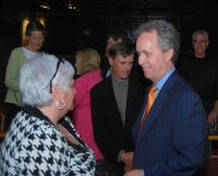 Louisville Mayor Greg Fischer speaking with one of the attendees.  Photo by Becky Gorman.
